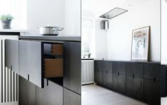 Simpel and elegant kitchen - via Coco Lapine.  Interior view of black plywood cabinet drawers.