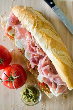 You'll feel like you're in Italy with this prosciutto, mozzarella and pesto-marinated tomato sandwich. A good sandwich is totally underrated. It's probably because I've had so many mediocre and just plain bad sandwiches in my life that I'm always Prosciutto Recipes, Tomato Mozzarella Sandwich, Delicious Sandwiches, Wrap Sandwiches, Gourmet Sandwiches, Wine Recipes, Beef Recipes, Cooking Recipes, Sandwich Recipes