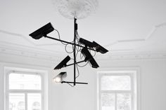 """""""Surveillance Chandelier"""" by Stockholm based designers Humans since 1982 Suspended Lighting, Unique Lighting, Banksy, Stockholm, Best Alarm, L Lawliet, Wireless Home Security Systems, Home Safety, Interiors"""
