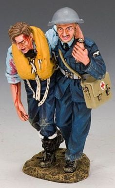 World War II British Royal Air Force RAF040 R.A.F. Medic & Wounded Pilot - Made by King and Country Military Miniatures and Models. Factory made, hand assembled, painted and boxed in a padded decorative box. Excellent gift for the enthusiast.