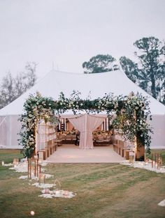 I do like a wide arbor to the reception tent, I like the decor with flower petals too. If too pricey, maybe to pedestal instead?