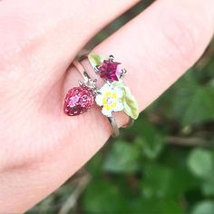 Bill Skinner Wild Strawberry Garden Ring Beautiful stack of rings with hand painted enamel detailing Size N A perfect gift for someone special, or yourself! Strawberry Garden, Wild Strawberries, Cute Rings, Swarovski Crystals, Jewelry Design, Hand Painted, Photo And Video, Fashion Rings, Flowers