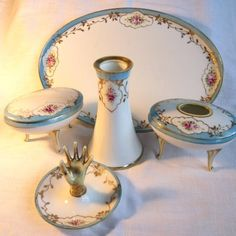 A Nippon Dresser (Vanity) Set decorated with Roses. One piece damaged.on Ruby Lane