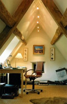 Love the modern lights between the ancient rafters in this attic #homeoffice