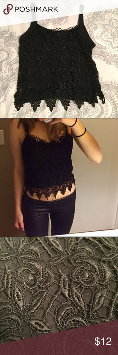 """Lace crop top Lace black crop top. Never worn. Crocheting all around. Perfect for festivals or every day wear. Styled similar to Tobi, Forever 21, Free People, Charlotte Russe, Express, Agaci, Akira, Urban Outfitters & more (: listed as free people reviews. Brand- """"awesome"""". Labeled as a size large, however I typically wear a size X-small and it fits perfectly, so I would say it would typically be around size small Free People Tops Crop Tops"""