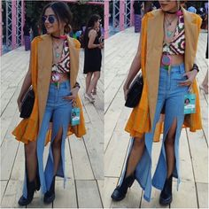 #AIFWSS17 Day 3, full outfit. Turned my hippie mode on.  Leheriya yellow shrug from @vajor, beige blazer from #sarojini. Gave slits to my bell bottoms, mirror work halter from #janpath.  #thecollegecouture #styleblogger #amazonindia #ootd #delhifashionblogger #fdci #aifw