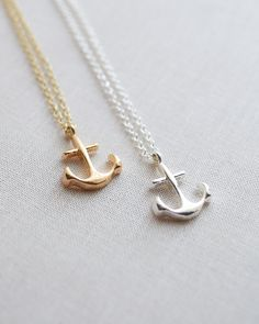 A petite anchor charm necklace is the perfect warm weather accessory. Available in gold or silver. By Olive Yew.