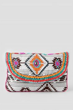 This colorful clutch features a black and white Aztec pattern with hot pink trim & vibrant seed beads embellishments. The decorative clutch is a great piece to elevate a basic outfit.