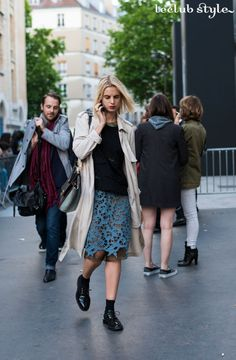Womenswear Street Style by Ángel Robles. Fashion Photography from Paris Fashion Week. See-through midi blue skirt with brogues and a trench. On the street, Rue Eugéne Spuller, Paris.