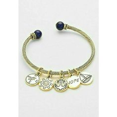 """Gold nautical beach open cuff bracelet NWT Trendy and chic gold tone cable cuff bracelet dazzled with nautical beach themed charms and tipped with nautural dark blue stones. Fits wrist 7 to 7.5"""" perfectly. Great quality and design. Brand new with tag. Jill Marie Boutique Jewelry Bracelets"""