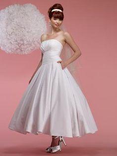 Birnbaum & Bullock Eloise - Used Wedding Dress with pockets.  Love the tea length skirt! | SmartBrideBoutique.com