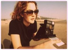 polaroids and sand covered beaches.