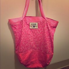 Victoria's secret pink cheetah tote bag RARE! Well loved Victoria's Secret pink tote bag. Lightly stained on handle arms, inside, and inner pocket. I used this bag for sleepovers over the years and it's time to part. I think the stain inside the pocket is tooth paste. Can deff be washed I just don't have the time to take care of it! Black words are in velour/velvet. Handles have a brown leather. Top zippers! Great bag for anything :) PINK Victoria's Secret Bags Totes