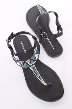 These trendy summer sandals include a faux leather upper with a T strap design, beaded detailing in a tribal pattern, thong post, slingback ankle strap with a side buckle closure, smooth lining, and cushioned footbed.
