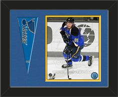 One framed 8 x 10 inch St. Louis Blues photo of Vladimir Tarasenko with a St. Louis Blues mini pennant, double matted in team colors to 14 x 11 inches.  (Pennant design subject to change) $59.99        @ ArtandMore.com
