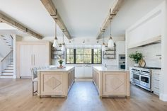 Kate Marker Interiors - Stoffer Photography - Vintage white glass and brass pendants hang from rustic wood beams over dual light brown oak plank kitchen islands. Home Interior, Interior Architecture, Interior Design, Interior Ideas, Home Design, Modern Design, Layout Design, Design Ideas, Kitchen Decor