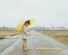 rain rainboots kid playing in the street ducks