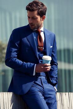 Indigo blue summer suit with double breasted vest. Paired with burgundy skinny knit tie and tie bar