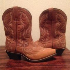 """NWOT Laredo Women's Saucy Western Boots NWOT! Style - 52094. Full grain leather, comfortable 9"""" shaft, snip toe, 2"""" heel, detailed stitch pattern on foot and shaft, comfort cushion insole. Never been worn. Size 7M Laredo Shoes Heeled Boots"""