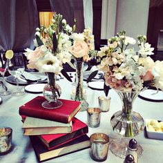 Last night's adorable table scape! Vintage books and boutique bud vases! So charming! #philadelphia #wedding #peach #white #vintagebooks #eventdecor #beautifulblooms #beautifulbloomsevents