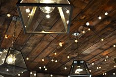 i love these pendants with the planked wood ceiling