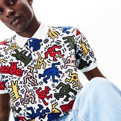 Lacoste presents a collection in tribute to the iconic artist Keith Haring, including this straight-cut Polo Shirt. Trendy with a pair of coloured jeans. Nice Outfits For Men, Keith Haring Prints, Polo Lacoste, Fashion Artwork, Le Polo, The Fashionisto, Pique Polo Shirt, Colored Jeans, Nike