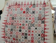 red and black Dear Jane.  The triangle blocks look like church spires