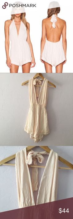 Somedays Lovin' Blessings Halter Playsuit Cute baby pink romper with plunging neckline, elastic stretchy waistband and a halter neck. In great condition; just needs to be steamed! Bought on Revolve! Sold out online. Somedays Lovin Dresses Mini