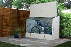 A bike storage shed is a place to park your bike safely. It help you protect your bike from theft an Bicycle Storage Shed, Bike Shed, Steel Storage Sheds, Shed Storage, Garbage Storage, Garage Velo, Bicycle Store, Wooden Sheds, Building A Shed