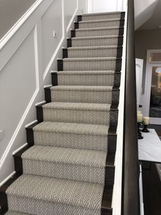 This herringbone carpet stair . This herringbone carpet stair runner is stair goals! Gorgeous patterned medium tone, durable carpet on dark stained stairs with white trim and white walls. Living Room Carpet, Carpet Design, Diy Carpet, Farmhouse Stairs, Staircase Design, Stairways, Durable Carpet, Carpet Staircase, Wood Stairs