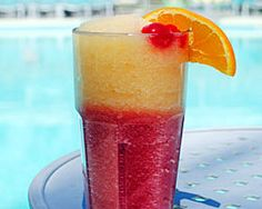Scottsdale Slurpee - Strawberry Dac layered with peach and pineapple frozen mix. Links to top 7 poolside cocktails in Greater Phoenix