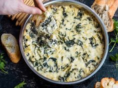 This Asiago-Loaded Spinach and Artichoke Dip Is A Game Day All-Star | Food & Wine goes way beyond mere eating and drinking. We're on a mission to find the most exciting places, new experiences, emerging trends and sensations.