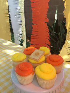 Orange and yellow cupcakes at a sunshine baby shower party! See more party planning ideas at CatchMyParty.com!