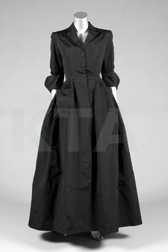A Balenciaga couture black silk evening coat, late 1940's