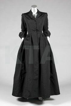 A Balenciaga couture black silk evening or deshabillé coat, late 1940s, Paris…