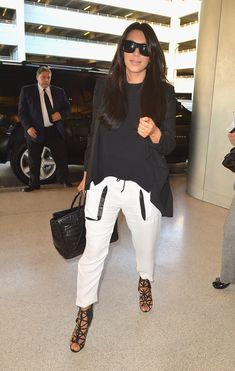 Indulge in loose, leather-trimmed pants at airports only. | 20 Groundbreaking Maternity Style Rules From Kim Kardashian