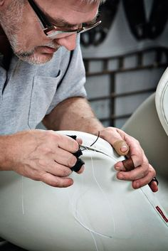 swan-chair-upholstery- craftsman at work