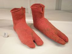 Oldest knitted socks in existence. Egyptian wool socks, designed to go with sandals, were knitted between 300 and 499 AD and found in the century