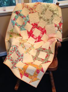 """Paula was inspired by blocks from Camille Roskelly's (thimbleblossoms) Simply Retro book and fabric from Bonnie and Camille's  """"Vintage Modern"""" and """"Marmalade"""" collections for Moda fabrics. Thanks Paula!"""