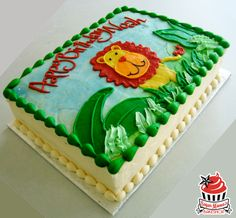 A fun jungle-themed birthday cake with striking green buttercream leaves.