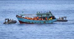 Australia closes the door on refugees arriving by boat.