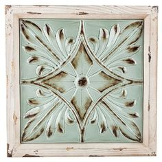 "Combine your own unique, sophisticated style with vintage-inspired flair. This Beige & Turquoise Wood & Metal Flower Wall Decor is the best of both worlds! Featuring a distressed beige wooden frame and a distressed minty turquoise green metal face with an embossed leafy flower design, this elegant yet shabby-chic piece will make a beautiful addition to a gallery wall or the wall of your bedroom, office or living room! Dimensions: Length: 14 1/4"" Width: 14 ..."