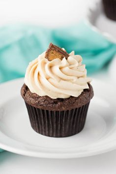 Peanut butter filled chocolate cupcakes with creamy frosting.