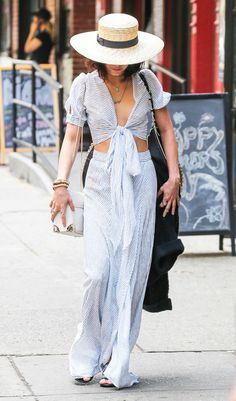 Vanessa Hudgens took a walk in New York in a striped bohemian look. While her crop top completes a flowing maxi skirt, the tie-front design would look just as lovely with high-waisted denim flares.