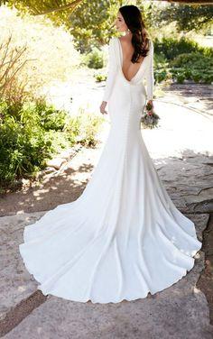 791 Long sleeved wedding dress with bateau neckline by Martina Liana Wedding…