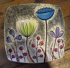 Hand painted dish with abstract floral pattern