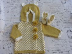 Hand knit 'bear' baby coat with matching booties by KNITLEBITS