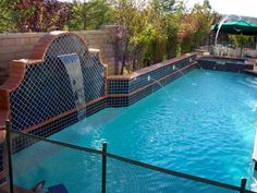 Aquatic areas should be fenced in with a self-closing, self-latching gate, especially if children are around. This pool has an unobtrusive guard along the side that prevents little ones from falling in. Design by Scott Cohen