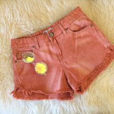 Free People Shorts Pink Denim Boho Tie Dye Cute FP denim shorts.  Cut-off style, the cut is at an angle it's really flattering    Perfectly frayed, they are sewn so they don't fray more. I bought these from a friend that does wardrobe for tv shows. When I got them they still had the FP tag on them, I wore them once but they were too loose on me .  Color is pink, it looks kinda like tie die, kinda like a distressed/ faded pink.  Tag says: Size W 26 Free People Shorts Jean Shorts