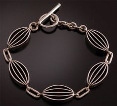 Gorgeous Shadow Box Silver Link Bracelet by Bahe (Navajo) | This bracelet is a stunning example of the artistry of the Navajo silversmith. Each piece is handmade out of sterling silver.